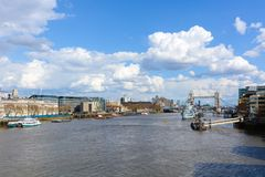 London : APRIL 12,2016 : HMS Belfast and Tower Bridge with the R Royalty Free Stock Photos