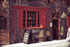 LONDON - April 9, 2014: Traditional English pub serving ales and Royalty Free Stock Photos