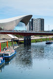 London Aquatics Center. London, UK - August 2nd, 2015: photo of the Queen Elizabeth Olympic Park, with the London Aquatics Center and people crossing over the Stock Photo