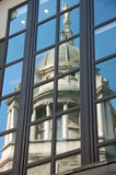 London Architecture - Royal Courts of Justice. Reflection of Royal Courts of Justice in tall office building windows. Possible use with themes of justice, mercy royalty free stock photo
