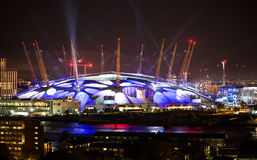 London arena under light performing. City lights background. Stock Photos