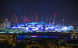 London arena under light performing. City lights background. Royalty Free Stock Image
