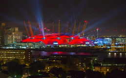 London arena under light performing. City lights background. Royalty Free Stock Images