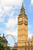 London attractions. LONDON, UK - JULY 9, 2014: View of the main attractions in London: Big Ben and London eye royalty free stock photo