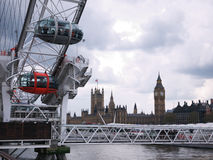 London-Auge und Häuser des Parlaments Stockbild
