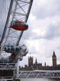 London-Auge und Häuser des Parlaments Lizenzfreie Stockbilder
