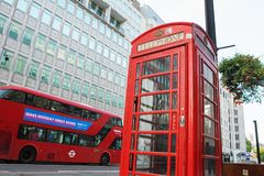 LONDON - AUGUST 19, 2017: Red telephone box and double decker bu. S, London UK Stock Images