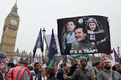 London Austerity Protest. Austerity protesters march on Parliament in opposition to government spending cuts on March 26, 2011 in London, UK. An estimated 250 royalty free stock photo