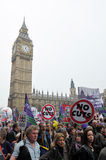 London Austerity Protest. Austerity protesters march on Parliament in opposition to government spending cuts on March 26, 2011 in London, UK. An estimated 250 stock image