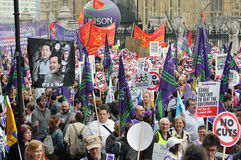 London Austerity Protest. Austerity protesters march on Parliament in opposition to government spending cuts on March 26, 2011 in London, UK. An estimated 250 stock images