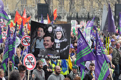 London Austerity Protest. Austerity protesters march on Parliament in opposition to government spending cuts on March 26, 2011 in London, UK. An estimated 250 stock photo