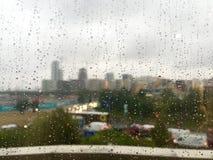 London in Autumn. Rain drops on windows Royalty Free Stock Image