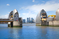 London barrier on the River Thames and Canary Wharf Stock Photography