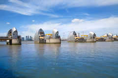 London barrier on the River Thames and Canary Wharf Stock Photos