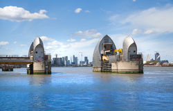 London barrier on the River Thames and Canary Wharf Royalty Free Stock Photography