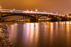 London. Battersea  Bridge Thames River London by night Stock Images