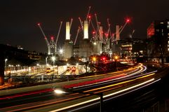 London Battersea Power Staton at night with trains and cranes. royalty free stock images