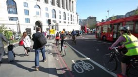 London Bicycle Commuter. LONDON - APRIL 21 : Bicycle commuters on April 21, 2015 in London, UK. Bicycle commuters on their way to work after crossing Blackfriars stock footage