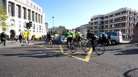 London Bicycle Commuter. LONDON - APRIL 21 : Bicycle commuters on April 21, 2015 in London, UK. Bicycle commuters on their way to work after crossing Blackfriars stock video footage