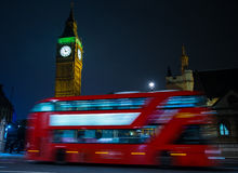 London Big Ben and double decker bus. Night view on London landmarks Big Ben Clock and motion blur of double decker red bus Stock Photo