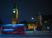 London Big Ben and double decker bus. Night view on London landmarks Big Ben Clock and motion blur of double decker red bus Royalty Free Stock Image