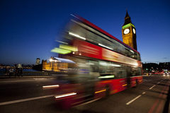 London Big Ben and red bus at night. London night scene with red bus in front of Houses of Parliament with Big Ben Stock Images