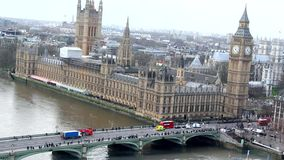 London, Big Ben, Thamse river. Westminster bridge with cars and red buses , people walking on it stock video footage