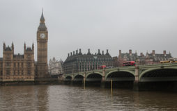 London - Big Ben tower and Westminster Bridge with a red double decker buses Royalty Free Stock Photos