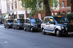 London Black Cab. Typical London black cabs in borough of south kensington stock photos