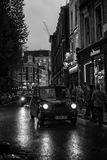 London Black Cabs. A black cab at nighttime in London stock photos