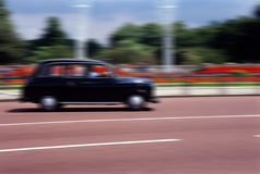 London Black Taxi. London black taxi (cab).speeds along the mall in city centre stock photography