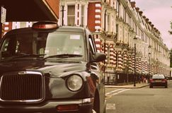 London black taxi cab. On a street in Notting Hill the Royal Borough of Kensington and Chelsea, central London stock photos