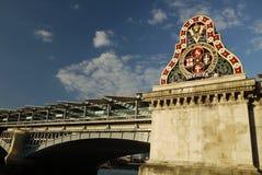 London: Blackfriars Bridge sign. 1864 Blackfriars Bridge historic sign with solar panels behind Stock Photos