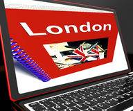 London Book On Laptop Shows Britain Guide Royalty Free Stock Photos