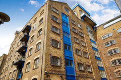 London brick buildings along the Thames river Royalty Free Stock Image