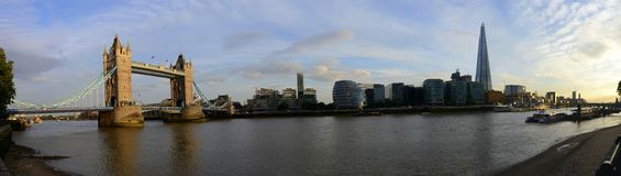 London Bridge, financial buildings and Thames river panorama. Beautiful panorama of London's skyline with London bridge and London Tower over the Thames river Stock Image