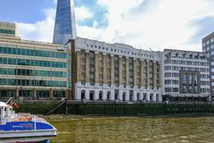 London Bridge Hospital taken from a boat on the river Thames. South Bank, London, UK - June 8, 2018: View of London Bridge Hospital building on the bak of the royalty free stock photos