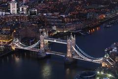 London bridge at night aerial view, close up. Close up of the London bridge at night from the Shard at night. Thames river at night Royalty Free Stock Photo