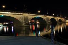 London Bridge at night. This night photo was taken of the London Bridge in Lake Havasu City, Arizona. Many of the lights have a starburst effect and multiple Stock Image