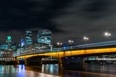 London Bridge at Night. With the London skyline in the background Stock Photography