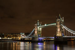 London bridge at night. View of the London bridge at night from the Thames' bank at night Royalty Free Stock Image