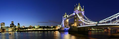 London Bridge over Thames river night panorama, UK. Beautiful panorama of London's skyline with London bridge and London Tower at night over the Thames river Royalty Free Stock Photo