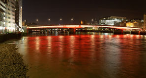 London Bridge with red and orange lights at night Royalty Free Stock Photos