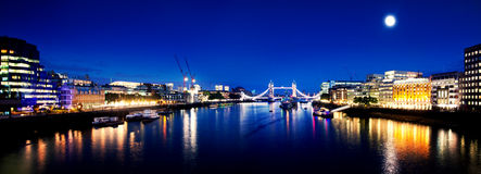 London Bridge and River Thames panorama by night Stock Images