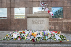 London Bridge tribute to terrorist victims. London, UK - 7 June 2017: Floral tributes laid on London Bridge as a memorial to the victims of the terrorist attack Royalty Free Stock Photography