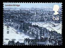 London Bridge UK Postage Stamp. UNITED KINGDOM - 2002: A Postage Stamp from the UK containing an image of the London Bridge in London, circa 2002 royalty free stock photo