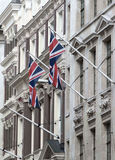 LONDON, British flags on  building facade. City of London Stock Image