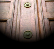 In london  brown door  rusty  brass nail and light Stock Photos