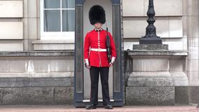 London Buckingham Palace, Armed English Guard Marching and Guarding 4K.  stock video footage