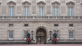 London Buckingham Palace, Armed English Guard Marching and Guarding 4K.  stock video